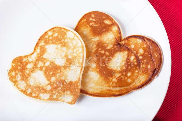 Romantik kahvaltı iki krep plaka akşam yemeği Stok fotoğraf © AGorohov