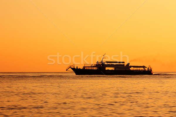 Cruise Ship At Sunset Stock photo © AGorohov
