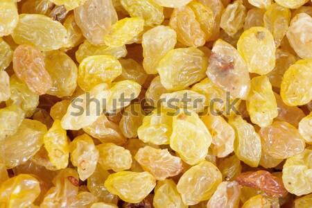 Golden yellow raisins background Stock photo © AGorohov