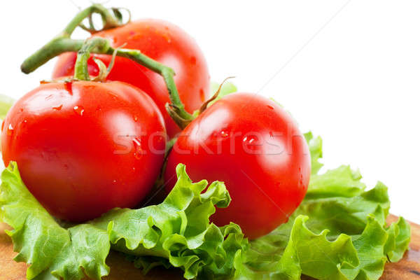 Tomates primer plano vista tres lechuga hoja Foto stock © AGorohov