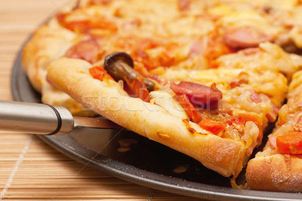 Stock photo: A slice of pizza