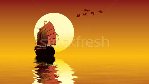 Stock photo: Sunset over the ocean