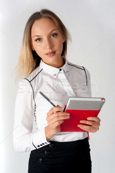 Pretty businesswoman standing with organizer diary Stock photo © Aikon