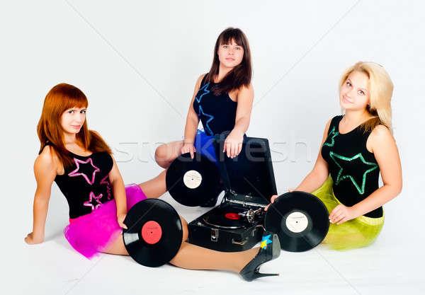 Tres bastante ninas gramófono jóvenes hermosa Foto stock © Aikon