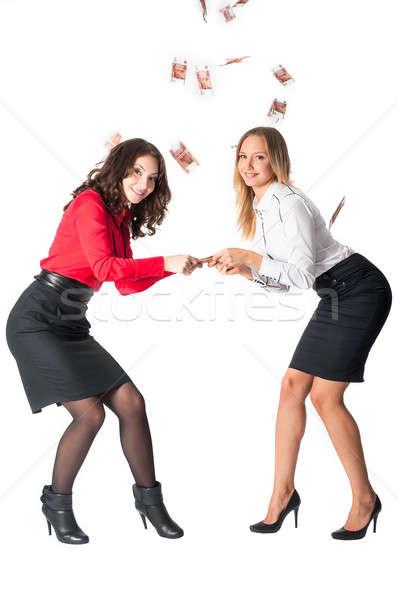 Jonge aantrekkelijk onderneemsters geld twee business Stockfoto © Aikon