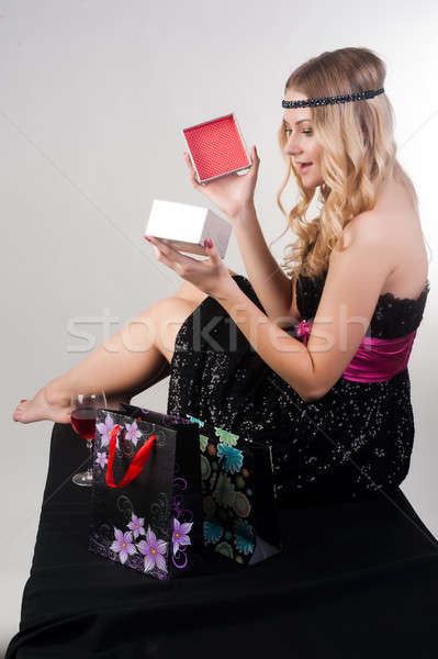 Pretty blond woman with gift bag Stock photo © Aikon