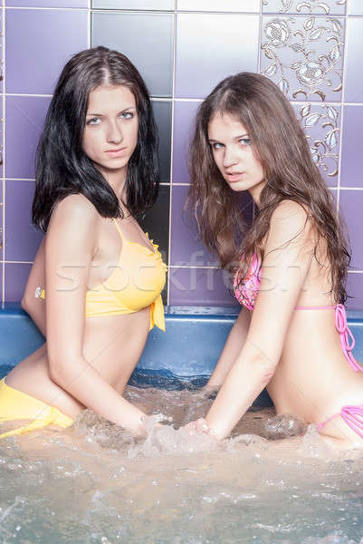Pretty girls in massage bath Stock photo © Aikon