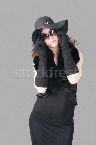 Retró stílus nő szemüveg fiatal gyönyörű nő szemüveg Stock fotó © Aikon
