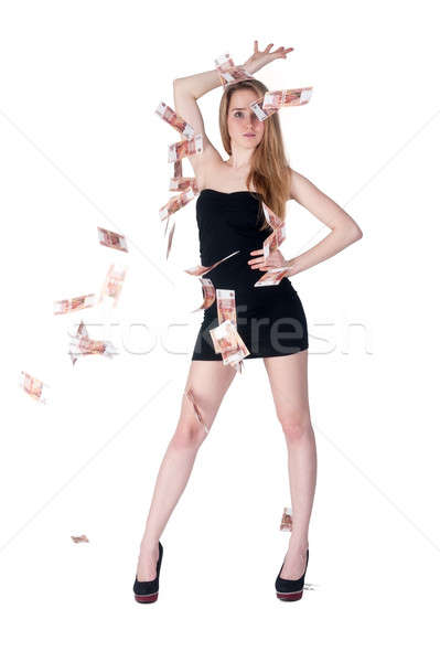 Beautiful young lady among flying cash Stock photo © Aikon