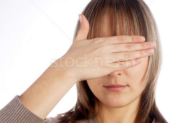 Woman covering eyes Stock photo © Aikon