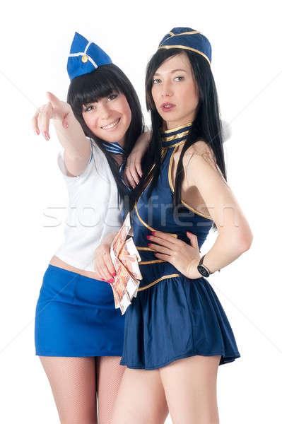 Two pretty stewardess with money Stock photo © Aikon