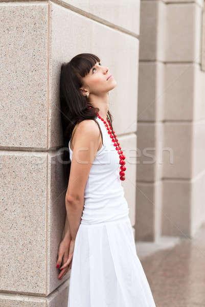 Aantrekkelijk triest meisje Rood kralen jonge Stockfoto © Aikon