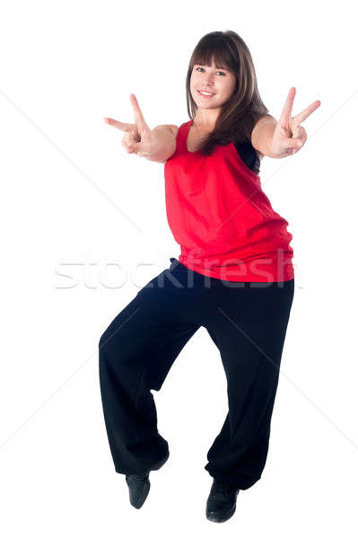 Young attractive woman with victory gesture Stock photo © Aikon
