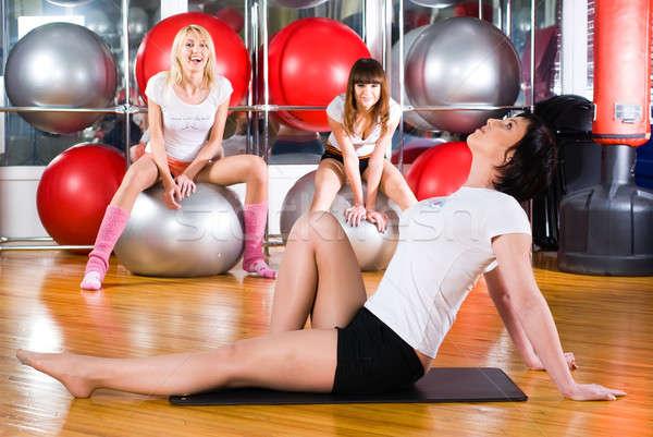 Girl in fitness center Stock photo © Aikon
