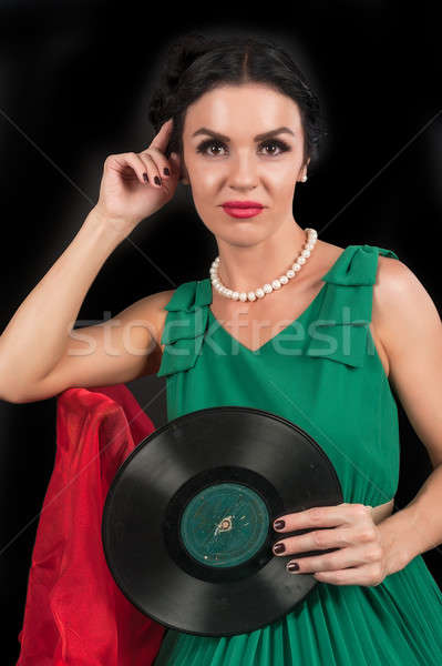 Pretty girl holding retro vinyl disc Stock photo © Aikon