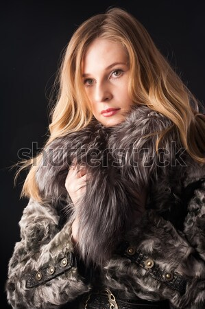Attractive woman in fur coat Stock photo © Aikon