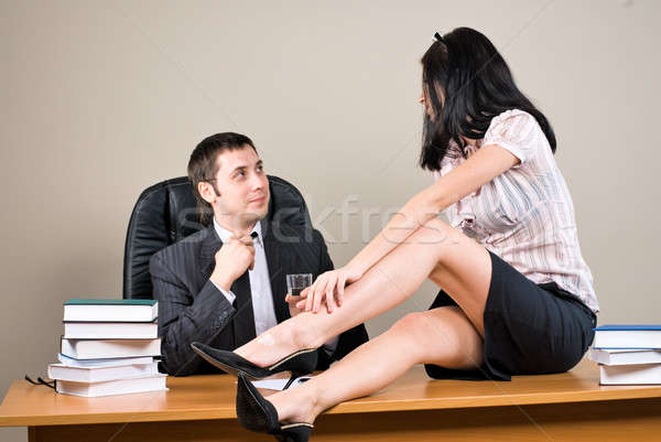 Businesswoman is seducing her boss at office Stock photo © Aikon