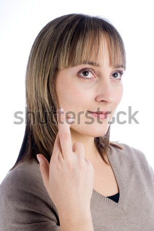 Girl with crossed fingers Stock photo © Aikon