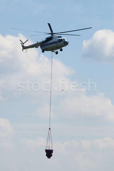 огня вертолета Flying воды цистерна небе Сток-фото © Aikon