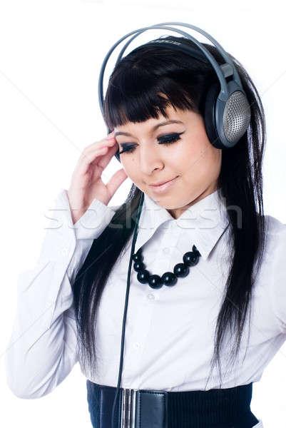 Woman listening music Stock photo © Aikon