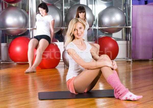 Pretty girls in fitness center Stock photo © Aikon