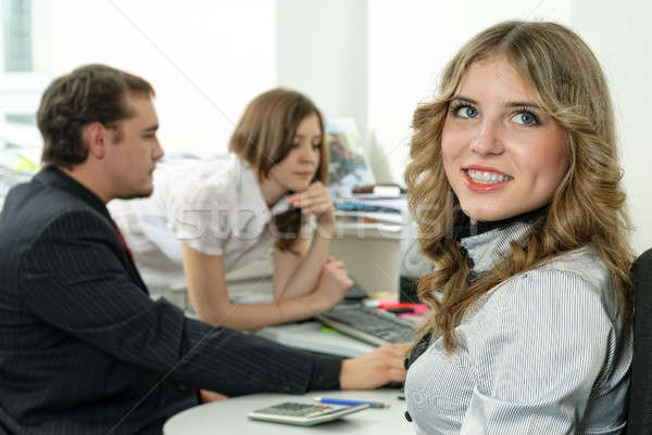 Attractive business lady smiles in office Stock photo © Aikon