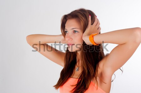 Hear no evil. Young pretty woman covering her ears Stock photo © Aikon