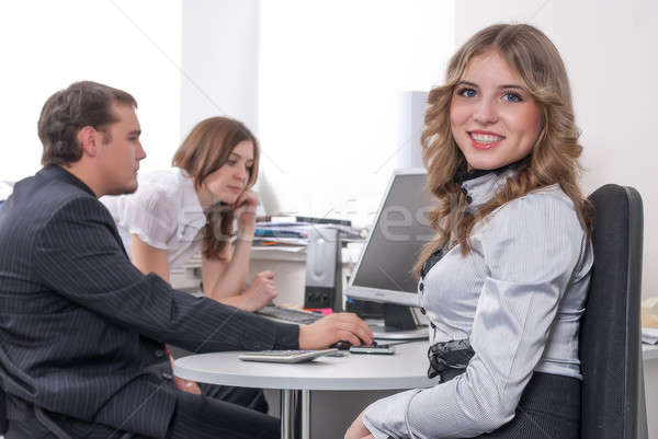 Young business lady smiling in office Stock photo © Aikon