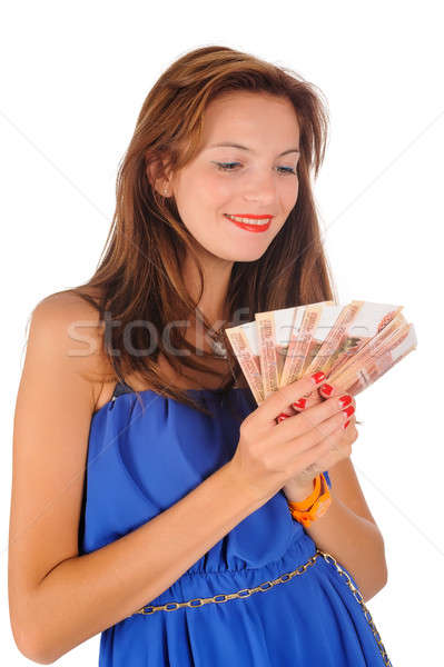 Young smiling woman with freckles holds cash Stock photo © Aikon