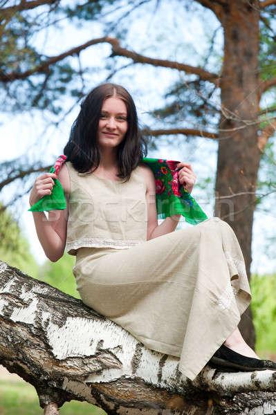 Gyönyörű nő nyírfa fiatal csinos nő ül erdő Stock fotó © Aikon