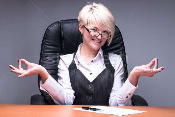 Loiro empresária meditando jovem atraente mulher de negócios Foto stock © Aikon