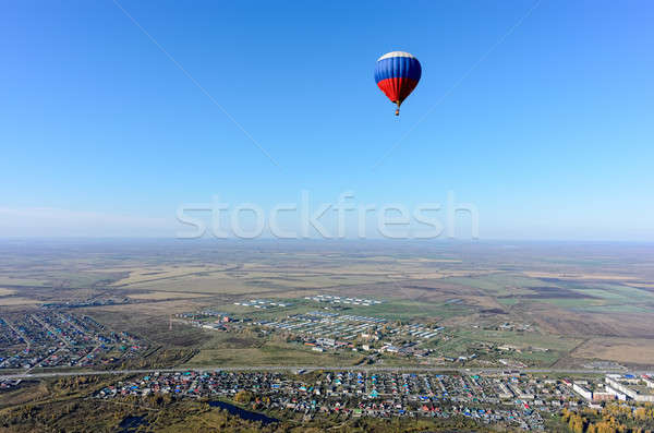 Flight of hot air balloon over rural landscape Stock photo © Aikon