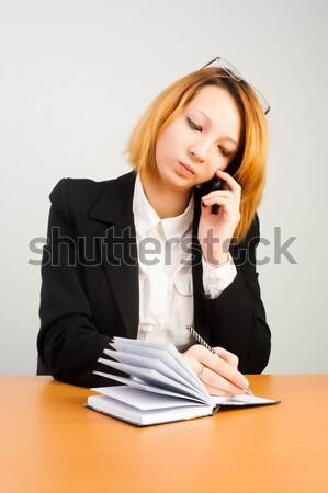 Young red-haired businesswoman Stock photo © Aikon