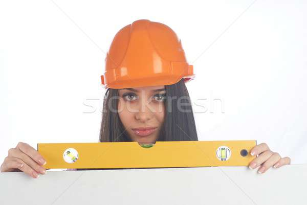 Woman in helmet wyh level Stock photo © Aikon