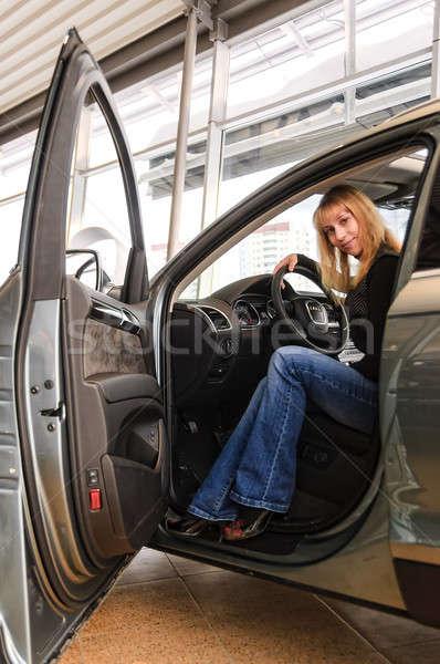 Kadın oturma marka yeni araç çekici sarışın Stok fotoğraf © Aikon