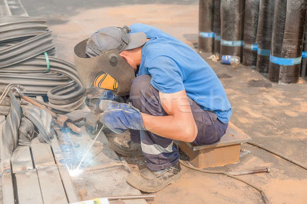 industrial worker welder during working process Stock photo © Aikon