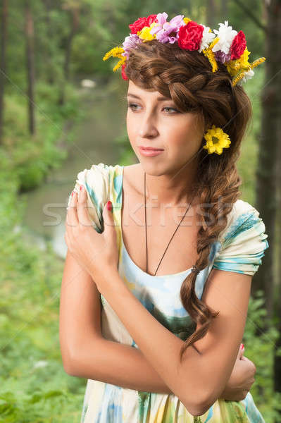 Young beautiful woman in wreath of flowers Stock photo © Aikon
