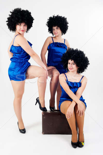 Three pretty dancers with old suitcase Stock photo © Aikon
