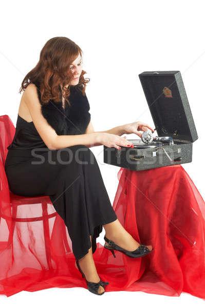 Güzel kadın dinlemek müzik genç güzel bir kadın oturma Stok fotoğraf © Aikon