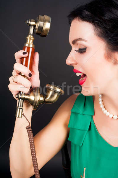 Pretty woman crying in phone tube Stock photo © Aikon