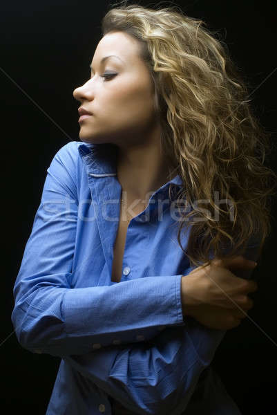 Attractive brunette woman in blue shirt Stock photo © Aikon