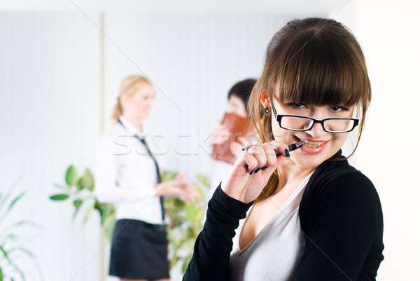 Pretty young Businesswoman in office Stock photo © Aikon