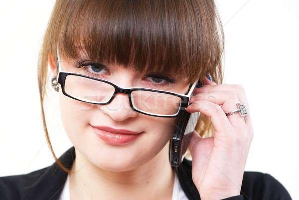 Сток-фото: говорить · девушки · мобильных · молодые · улыбающаяся · женщина · мобильного · телефона