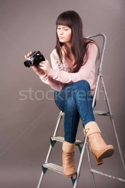 young woman with video camera Stock photo © Aikon