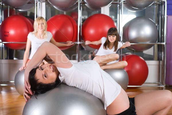 Pretty girl in fitness center Stock photo © Aikon
