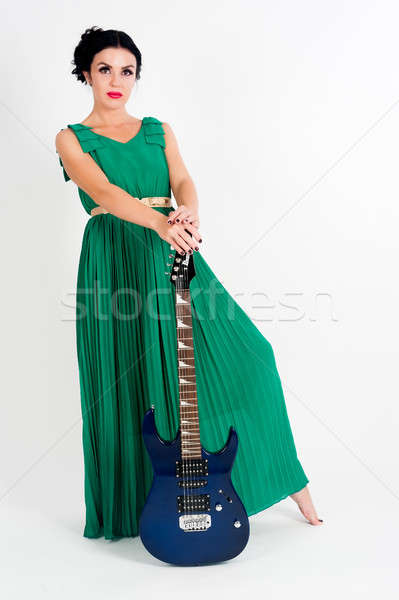 Güzel kadın uzun yeşil elbise gitar genç Stok fotoğraf © Aikon