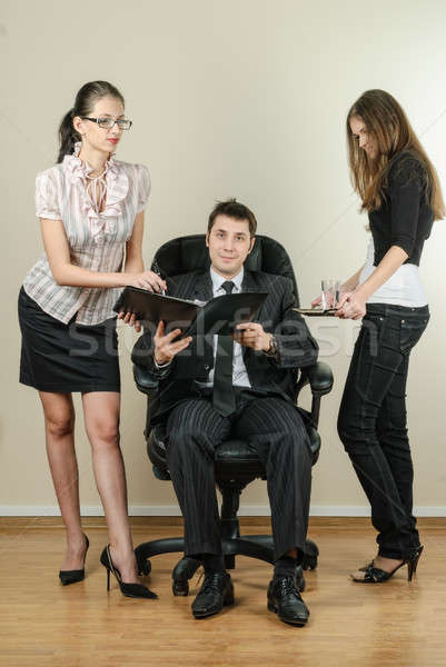 Elegant secretaries and manager man in office Stock photo © Aikon