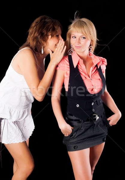 Fille chuchotement amis oreille une fille autre Photo stock © Aikon