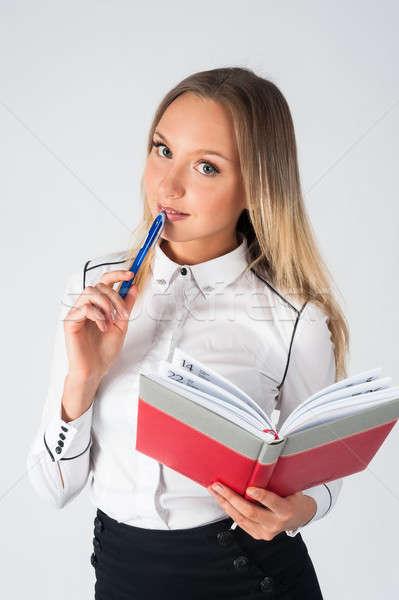 Bastante empresária em pé organizador diário amigável Foto stock © Aikon