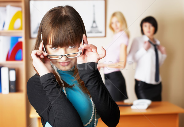 Young pretty business lady in office Stock photo © Aikon